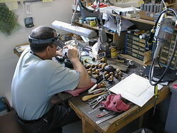 Master Hand Engraver cutting dies by hand